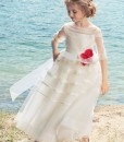 Sequin embellished dress with illusion neckline and red flower decor from Papilio Kids Ceremony Collection