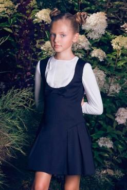 Sleeveless dress with bow décor